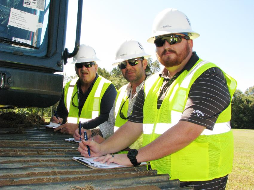 Doing their paperwork on machine assessment of an HX330L excavator (L-R) are Larry Hefner, Four Seasons Equipment, Dallas, Texas; Beau Winfield and Jeremy Foster of Cisco Equipment, Odessa, Texas.