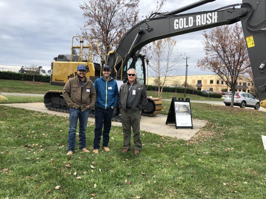 (L-R): Riley and Tyler Lecka of Wild Lands Engineering in Charlotte and Ascendum Machinery's Steve Brown talk about the durability of Volvo excavators working in the frozen Alaskan tundra.