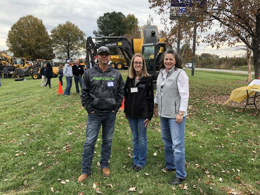 (L-R): Brian Owens of Stewarts Grading & Hauling in Germanton, N.C., with Katelyn Pandy and Kristin Parker, both of Ascendum Machinery.