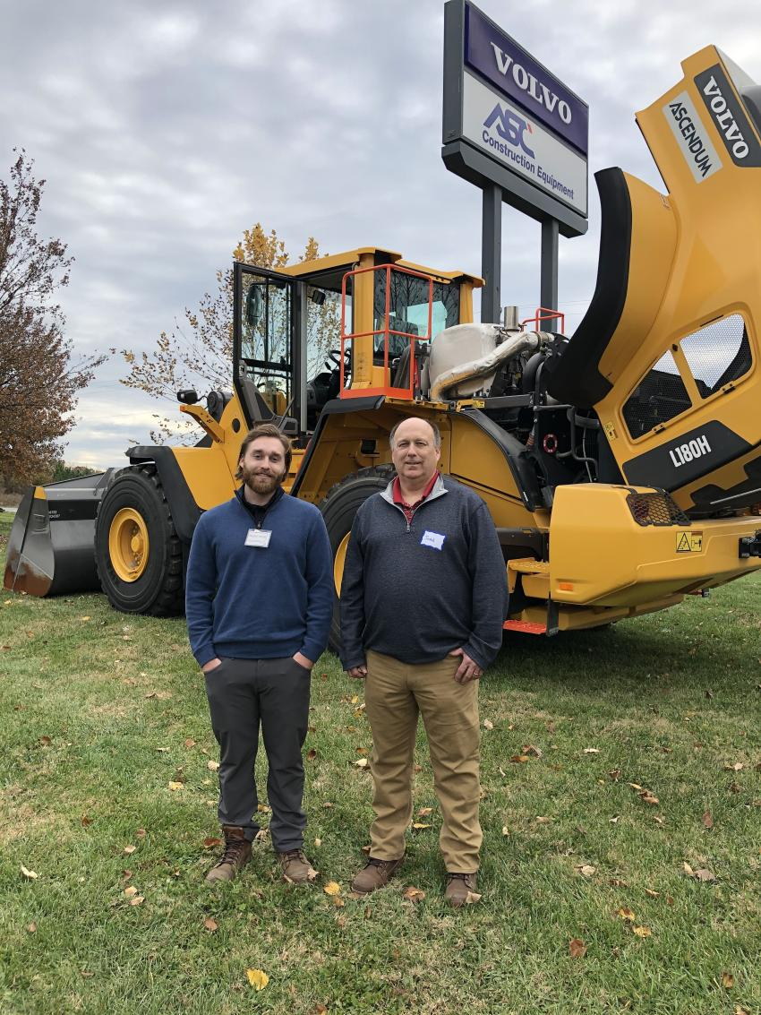 Marco Loureiro (L) of Ascendum Machinery and John Okerson of Bank of the West.