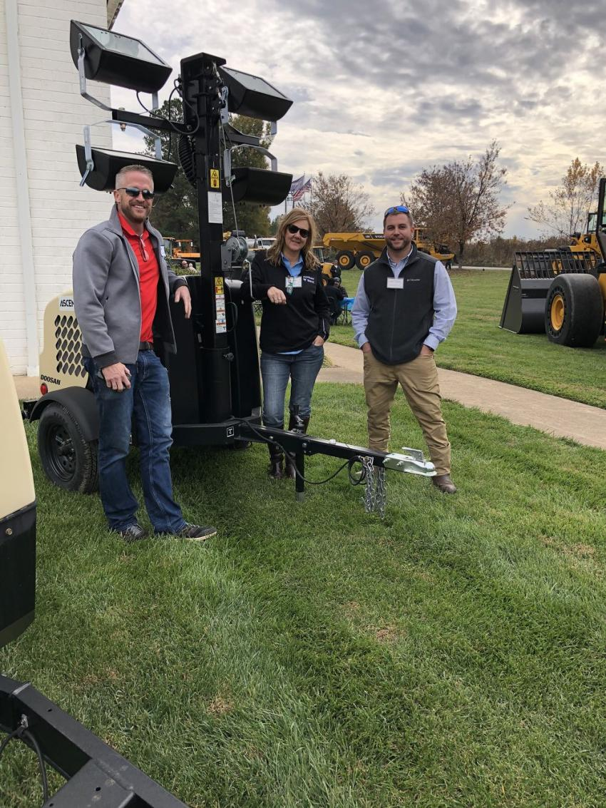 (L-R): Chad Cooke of Cooke Rentals in Denver, N.C., Deree Bivins of Doosan Portable Power in Statesville, N.C., and Jordan Thacker of Ascendum Machinery with the Doosan LCV6 light tower.