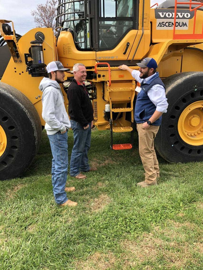 Matt McDaniel (R) goes over the Volvo L150H wheel loader with Robert and Lore Kerr of Piedmont Grading & Wrecking in Charlotte, N.C.