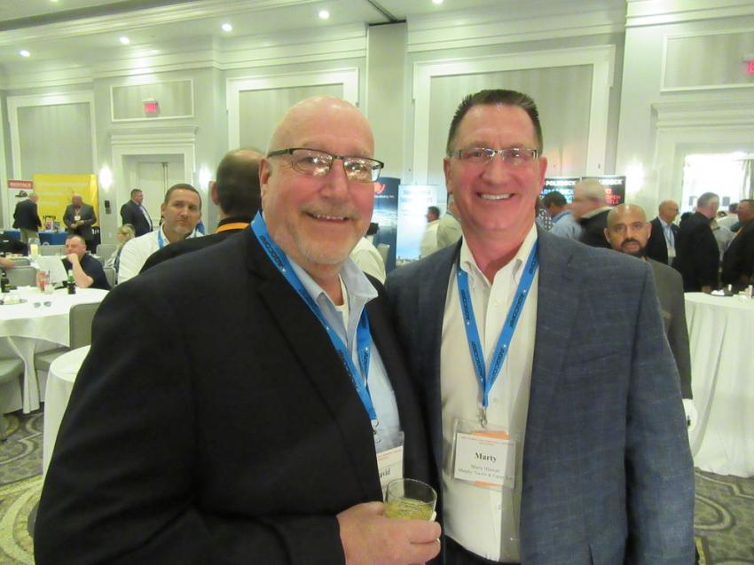 David Zimmerman (L) of the Melvin Stone Company caught up with Murphy Tractor's Marty Hlawati during the reception.