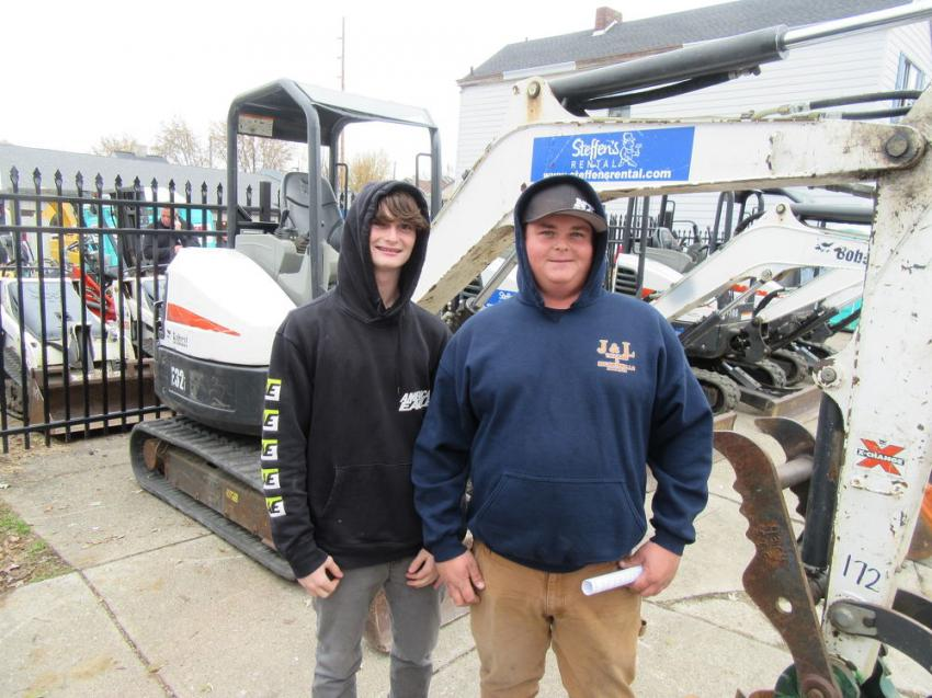 Brandon (L) and Cody Woodgeard of J&L Trucking and Excavating were on hand hoping to land some equipment bargains.