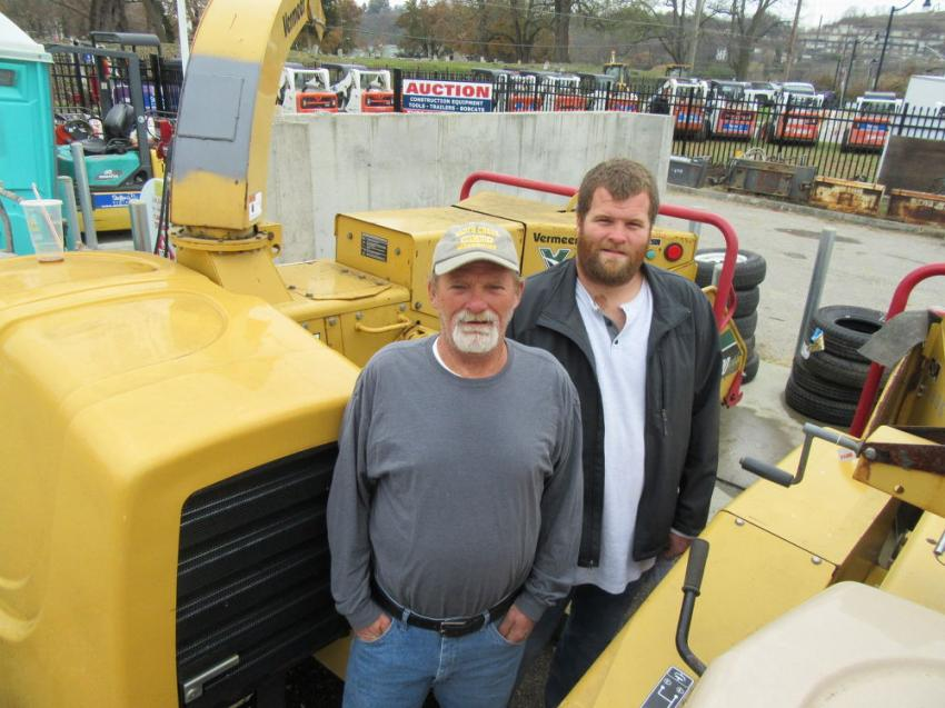 Father and son team Jim (L) and Kyle Willoughby of Willoughby Tree Service inspect this Vermeer BC1000 wood chipper.