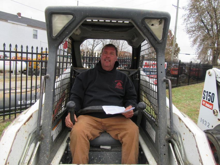 Todd Haggard of Preferred Ground Maintenance considers a bid on this Bobcat S150 skid steer loader.