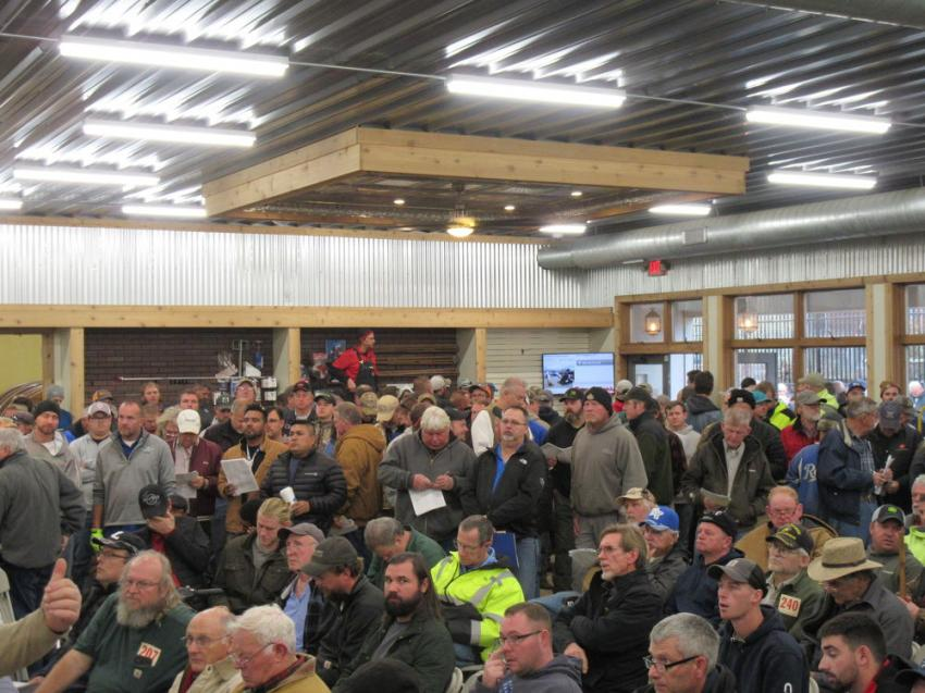 Hundreds of equipment buyers packed the indoor auction area while other auction attendees reviewed the equipment in the yard.