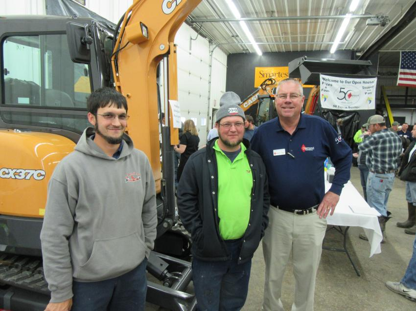 (L-R): Eldon and Ephraim Graber of Graber Brothers Remodeling and Construction are welcomed by Diamond Equipment's Mark Klodowski.