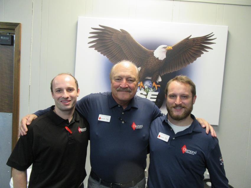 Travis (L) and Chase Clement (R) take a moment with their father Dave Clement to welcome attendees to Diamond Equipment's 50th anniversary celebration and Holiday Open House event.