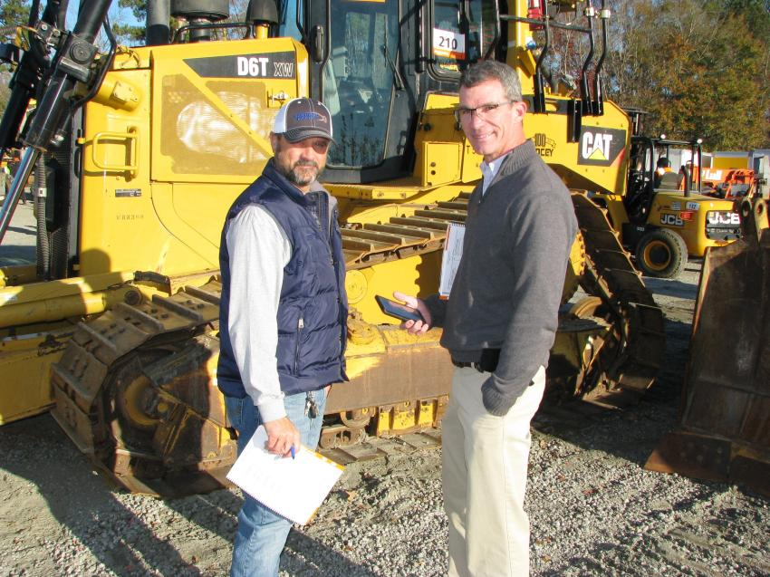 Kerry Grindle (L) and Brett Johnson of Vertical Earth, Cumming, Ga., were deep in discussion of a great looking Cat D6T XW.