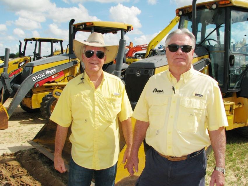 Monitoring the pricing on a large package of John Deere 310K backhoe loaders in the sale lineup are Mike Pursifull (L) of AQUIP Inc., Tampa, Fla., and Terry North of RDO Equipment Co., Florida used sales.