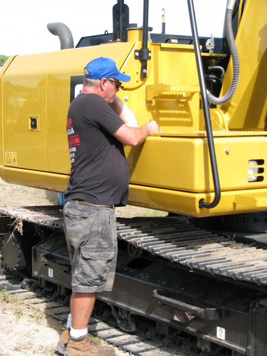 Rob Joyce of Equip Seller, Philadelphia, Pa., checks his notes on an excavator he purchased at the auction.