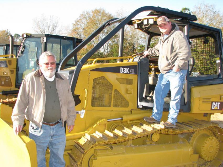Wrapping up an inspection of a Cat D3K XL dozer are John Chisenhall (L) and Curtis Chisenhall of Chisenhall Excavating, Fort Payne, Ala.