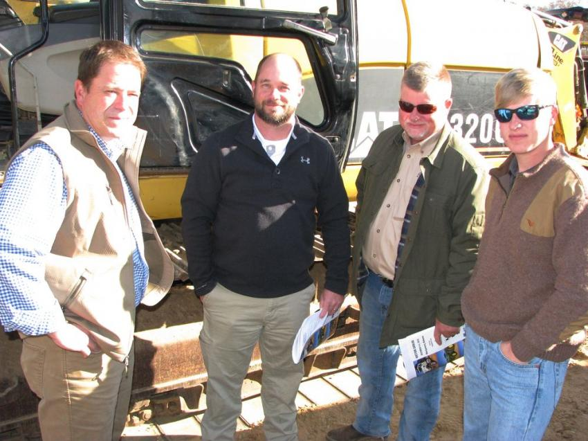 Discussing the equipment lineup (L-R) are Greg Frost and Adam Lewis of Thompson Tractor, Montgomery, Ala.; Danny Strock and Tyler Strock of Strock Farms, Montgomery, Ala.