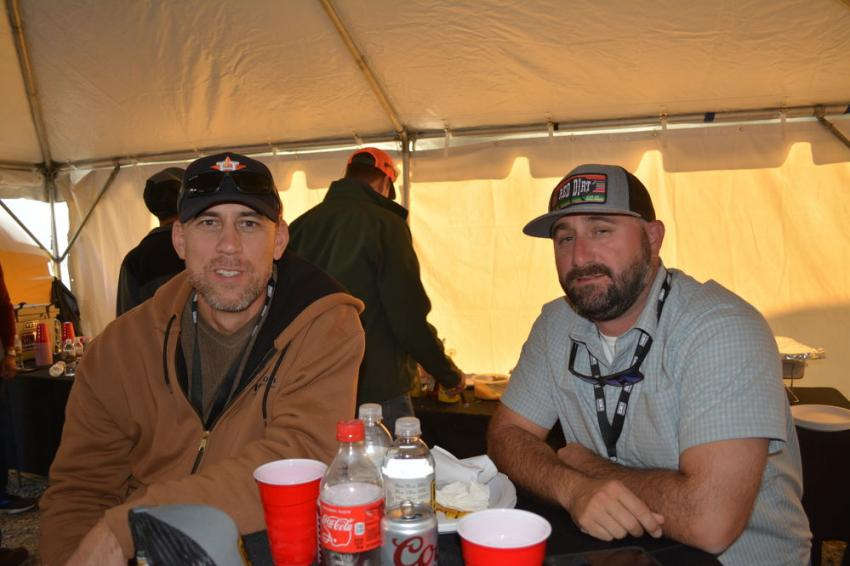 Darryn Lindsey (L) of Lehigh Hanson and Cody Nicholson discuss racing and ROMCO inside the hospitality tent.
