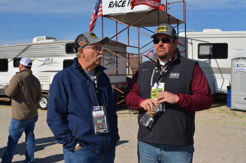 Paul Birkholz (L), ROMCO product support manager, and Austin Fitch, North Texas regional manager, await the arrival of customers at the ROMCO hospitality tent at Texas Motor Speedway.