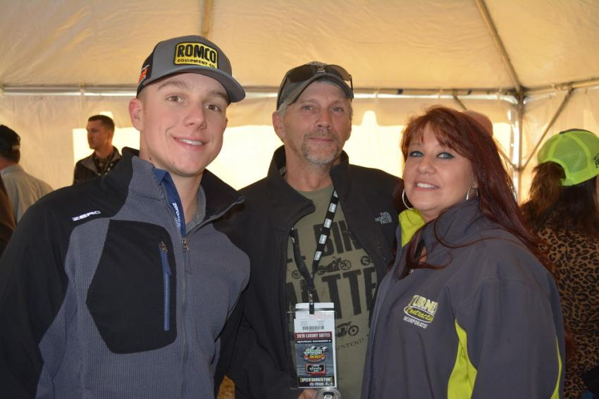 Mark Welton (C), superintendent of Turner Contracting, and his wife, Brooke, were able to meet and talk racing with John Hunter Nemechek, driver of the ROMCO Camaro in the NASCAR Xfinity series.