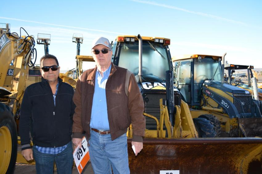 Tomas Olivas (L) and Steven Romney were among the many international buyers at the El Paso sale. They represent a large agricultural enterprise in the Mexican state of Chihuahua, which borders West Texas. They had a big selection of backhoe loaders to choose from.