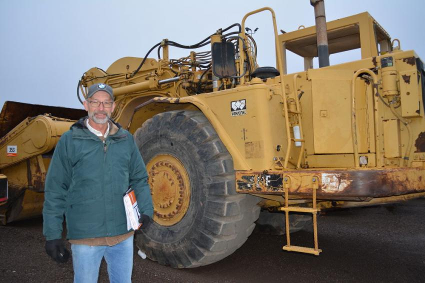 Temperatures in the low 30s did not prevent Rodney Blankenship from traveling to the Fort Worth auction from La Luz, N.M., to look at this Caterpillar 621F motor scraper. Blankenship operates R.D. Blankenship Dirt Work.