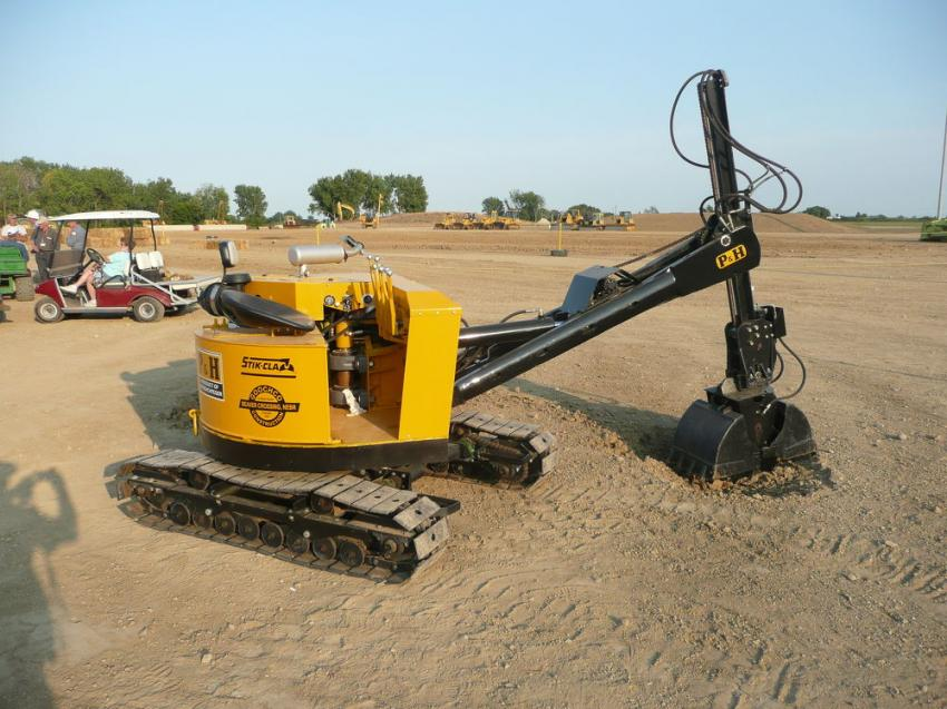 This is a 1962 P & H S-20 Stik-Clam, the earliest known compact excavator in the U.S. market and probably 30 years ahead of its time.  The stick-mounted hydraulic clamshell could dig at a wide range of angles, including to a surprising height. HCEA National Director Dave Geis of Seward, Neb., is the owner.