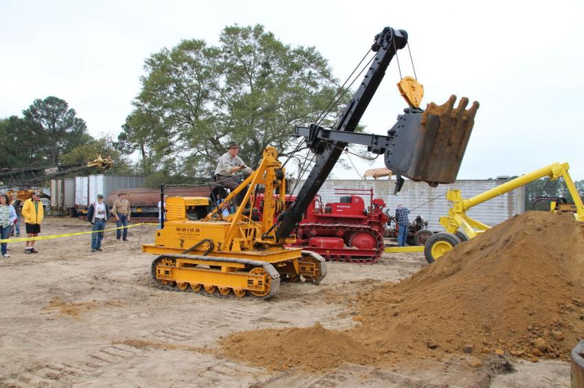 The Byers Bearcat Junior, built in the late 1930s, was one of the smallest cable excavators built. With its swing boom, it is in a sense a forebear of today's compact hydraulic excavators. HCEA National Director Larry Kotkowski is the operator.