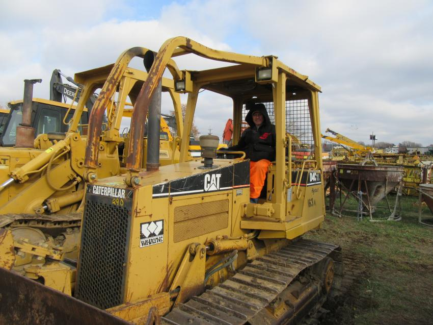 Kevin Riggs of Elizabethtown Manufacturing puts a Caterpillar D4CXL crawler tractor through its paces at the auction.