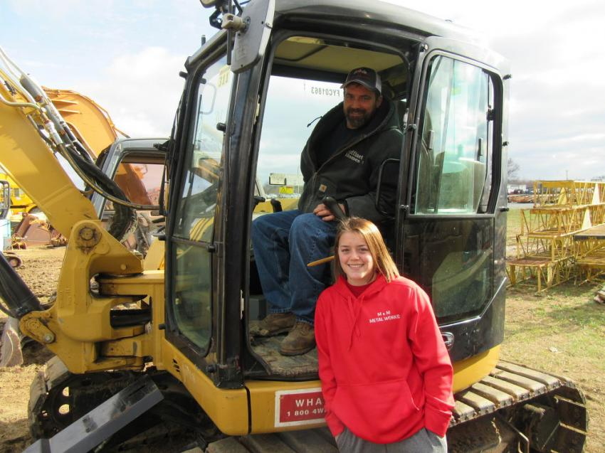 Nick Goffinet and daughter, Katie, talk over a bid strategy on this Cat 308 mini-excavator.