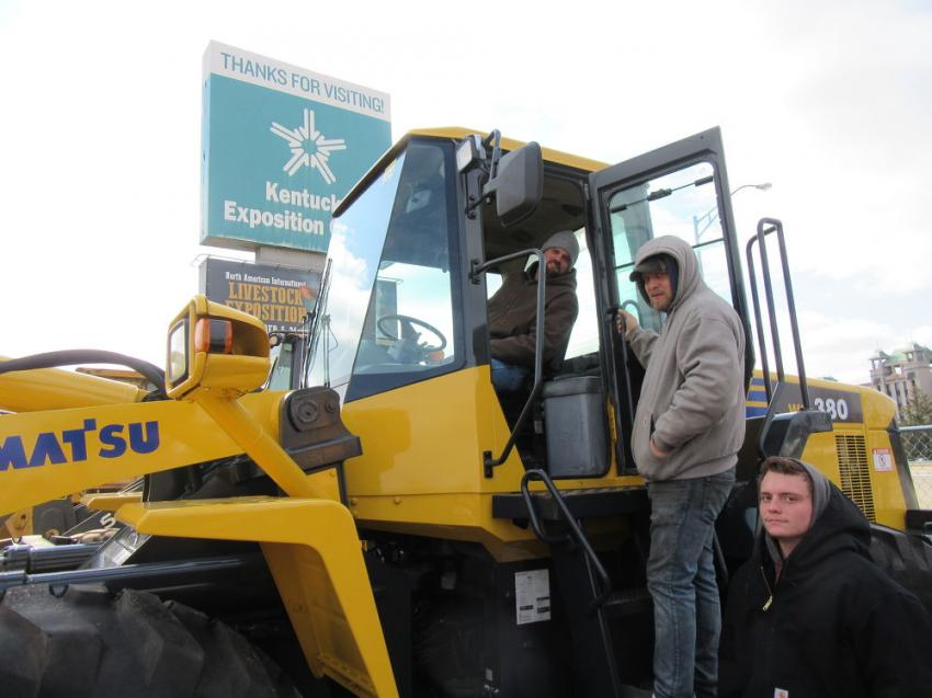 (L-R): Taylor County Recycling's Ted Blanford, along with Jackie and Sean Propes try out this Komatsu WA380 wheel loader at the auction.