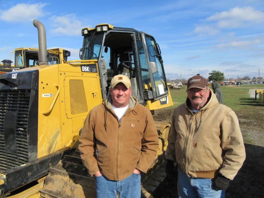 Father and son team, Brandon (L) and Brad Pardieck of BP2 Construction, were pleased to have placed the winning bid on this Caterpillar D6k dozer.