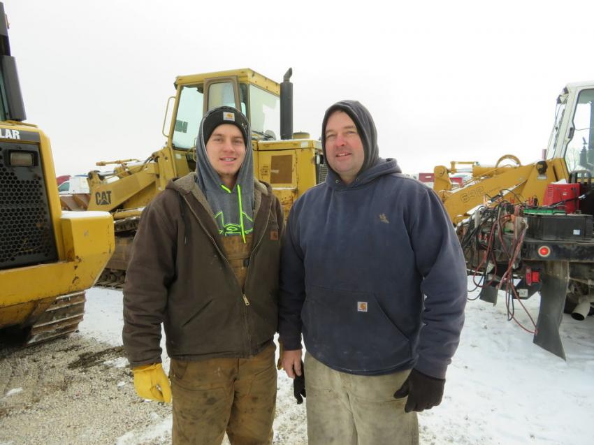 Ben Larson (L) and Dan Breunig, both of JM Mechanical, look over the iron at the Dec. 17 auction.