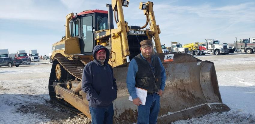 Patrick Nenereny (L) and James Frank are at the Ritchie Bros. Auction looking for equipment deals. The weather is great for this time of year in Minnesota.
