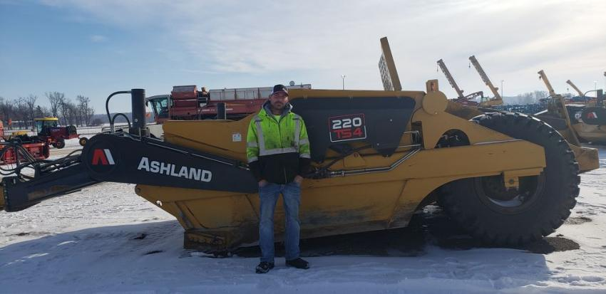 Checking out this nice Ashland 220 T54 scraper is Pat Chambers, president of Chambers Excavating, Mankato, Minn. He said it's a great day for an auction and is looking to buy any equipment that is priced right.