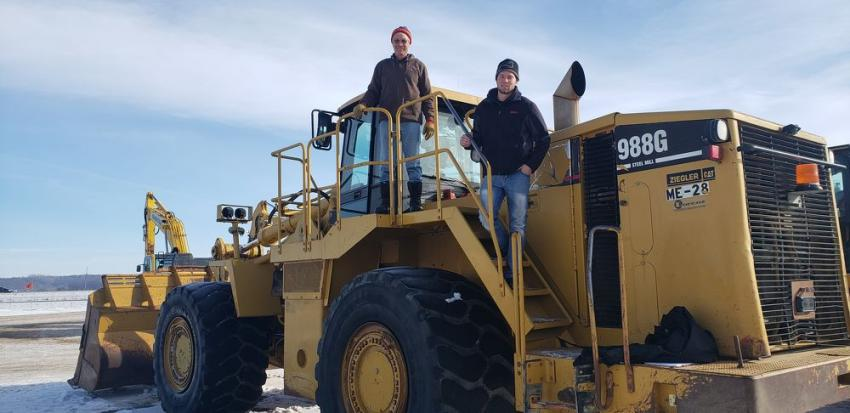 "(L-R): Kevin Cohrs and son, Tyler, of Cohrs Farms in Glencoe, Minn., purchased this nice Cat 988G loader for their gravel pit and snow removal operations. ""It is a super nice machine and priced right,"" said Kevin."