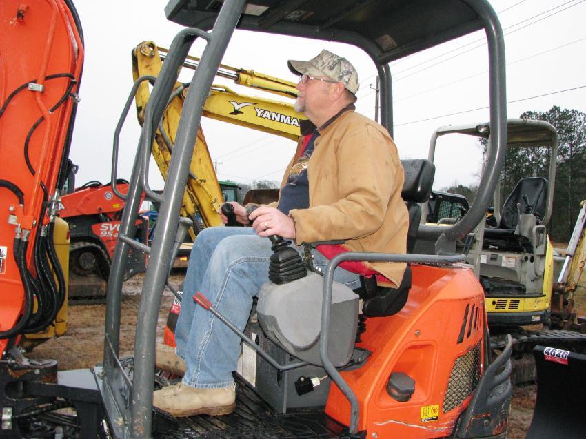 Test operating a Kubota KX91-3 mini-excavator is Mark Treadwell of Treadwell Millworks, Bremen, Ga.