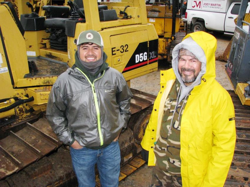 Checking out some of the quality dozers in the sale are William Rodriquez (L) and his dad Jose Rodriguez of Rodriquez Tree Service, Carrollton, Ga.