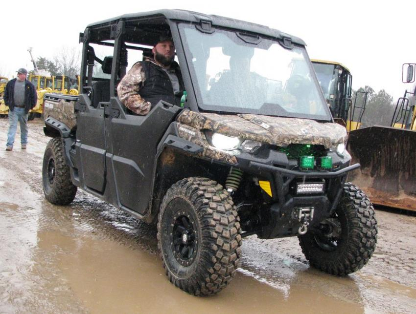 Matt Wilson and Jeff Hardy of WB Enterprises, Douglasville, Ga., prepared for a soggy rain-drenched day by loading up and bringing their CanAm Defender 4x4 to the sale.