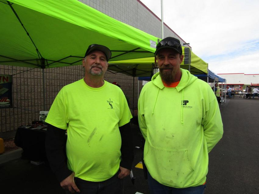 Paul Fields (L) and Paul Corbin of W&W Structural took a few minutes out of their work day to take advantage of the discounts and browse the vendor displays.