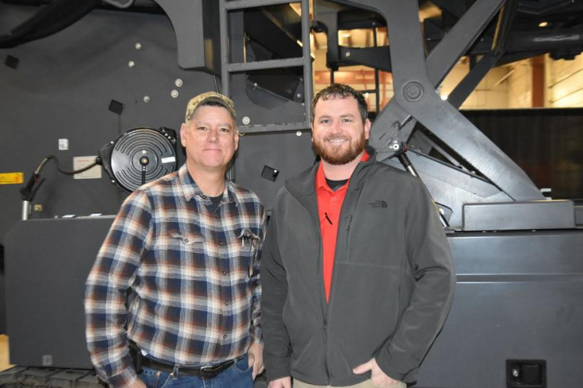 Kevin Harto (L), heavy equipment sales representative of Best Line Equipment, and Sean Engle, dealer sales manager of Dynapac.