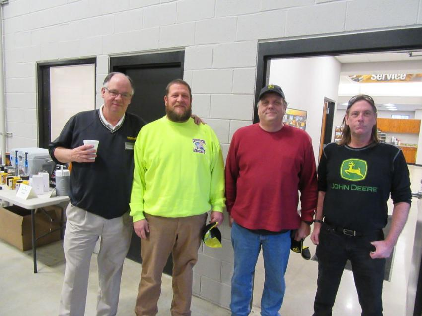 (L-R): Murphy Tractor & Equipment's Michael Camp welcomes Chris Benedict of CB Excavating & Trucking and Kirk Scheid of Scheid Enterprises, along with Bob Cumberland of Murphy Tractor & Equipment.