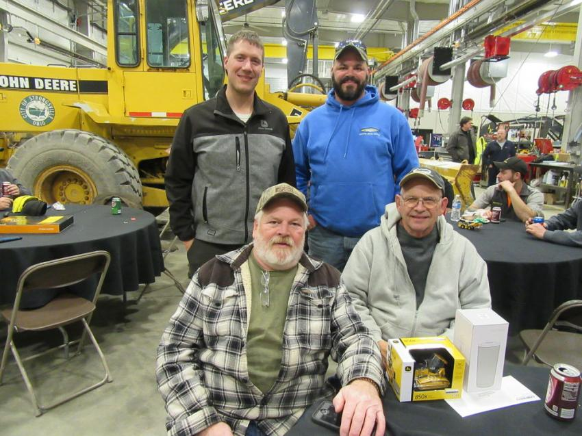 Murphy Tractor & Equipment's Ethan Irish (L standing) caught up with Steve and Jerry Apling of Apling Excavating and Trucking along with Timothy Churchill of Churchill Construction at the Brunswick Open House.