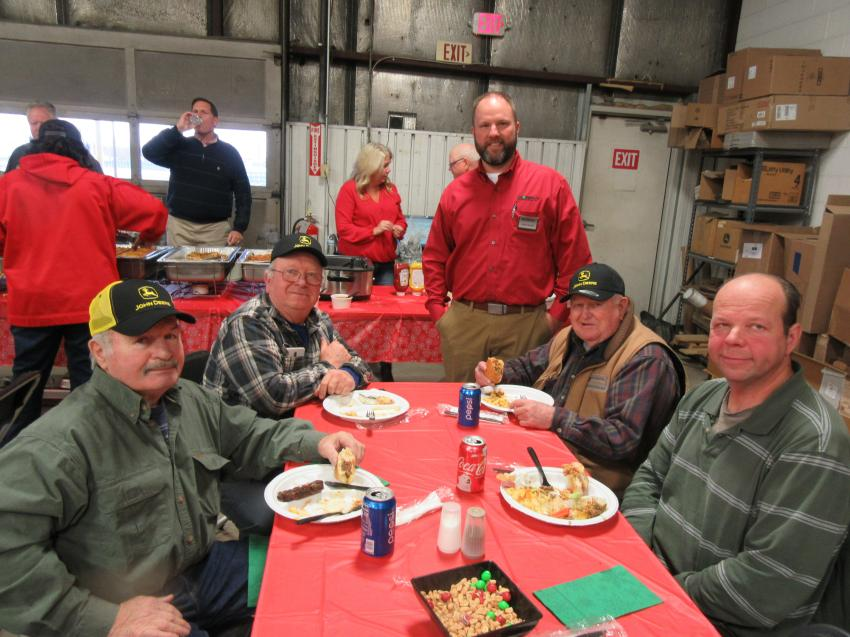 Chris Mears (standing), Murphy Tractor & Equipment's Canton branch manager, caught up with (L-R) John Croft & Son Excavating's Richard Croft, John Croft, Bob Smith and Steve Larson at the Canton Branch Holiday Open House.