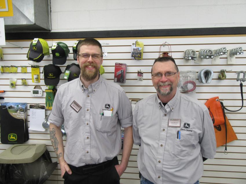 Mixing business with pleasure, Murphy Tractor & Equipment's James Fahlin (L) and Scott Weston, parts manager, stayed busy behind the parts counter welcoming attendees and taking care of their parts needs.