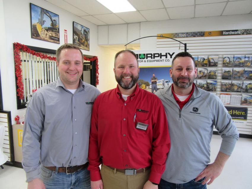 Chris Mears (C), Canton branch manager, felt the Holiday Open House was an excellent opportunity for Evan Robb (L), compact equipment sales manager, and Shawn Vallelonga, territory sales manager, who recently joined the Murphy Tractor & Equipment sales team, to get better acquainted with the dealership's customers in a relaxed setting.
