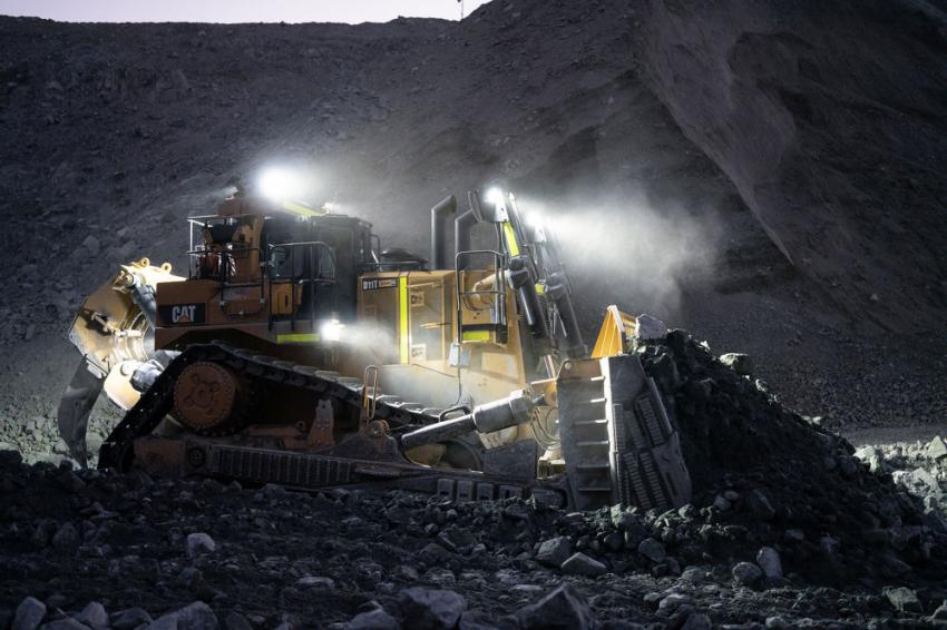 One of Graniterock's D11T's pushes blasted granite toward the mouth of its mobile crusher at the AR Wilson Quarry in Aromas.