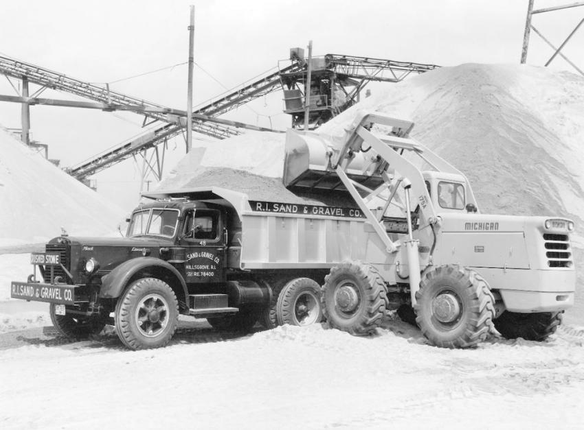 In Rhode Island — Rhode Island Sand & Gravel of Hillsgrove, R.I., purchased two new Mack LJSWX 10 wheelers in 1952. One of the Mack trucks is being loaded with washed sand with a Michigan 175A tractor shovel.