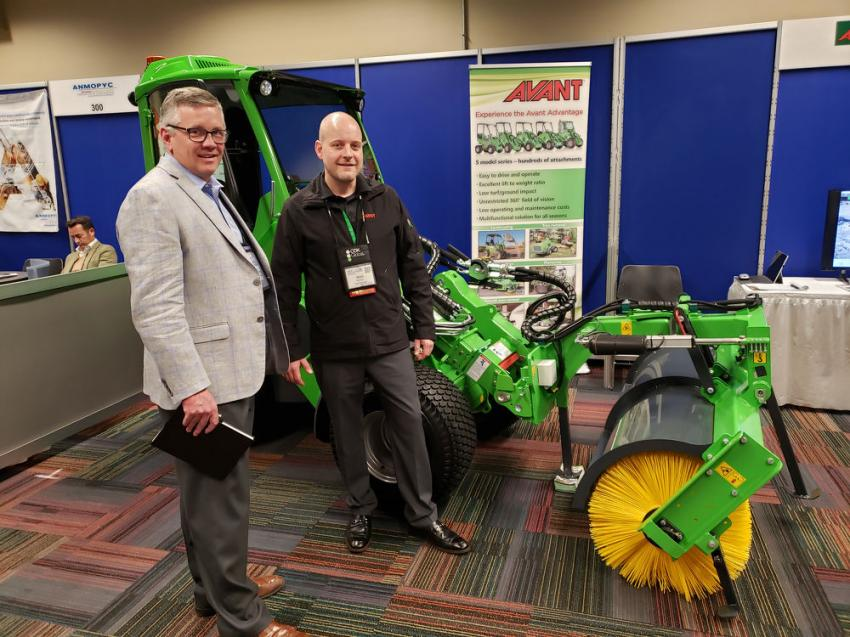 Robert Sloan (L), president of CE Rentals, Elmhurst, Ill., and Brent Bowman of Avant Techno, discuss the merits of Avant's product line, including this 640 articulating mini-loader.