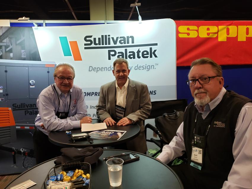 (L-R): Neil Noga of M.J. Miller Combined Companies Inc. goes over specs on compressors with Austin Wilkins and David Maguire of Sullivan Palatek.