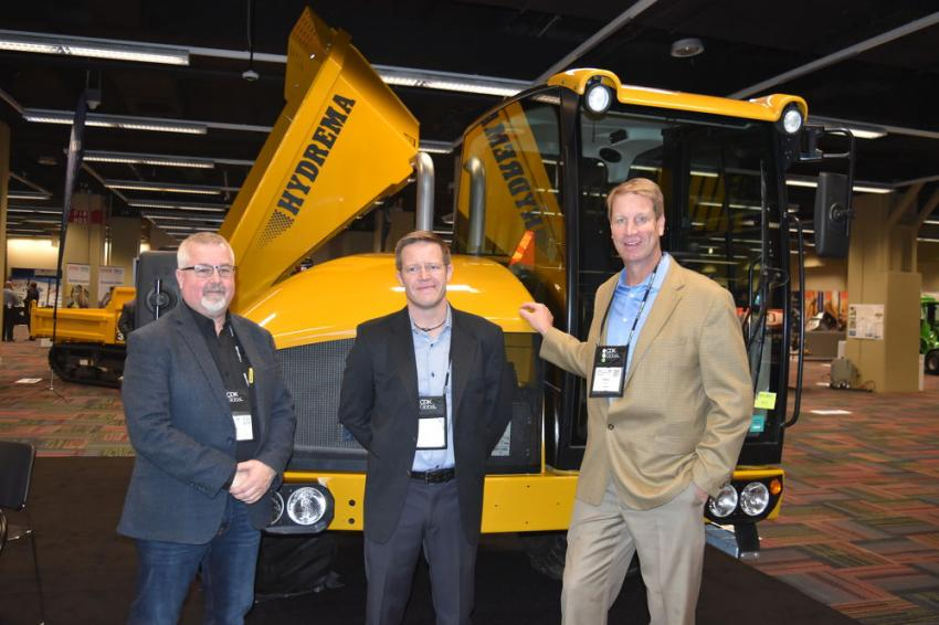 (L-R): Allen Patterson, regional business manager; Kresten Binder, executive vice president, North America; and Barry Ferrell, regional business manager of Hydrema, offer a line of side and articulated dumps in sizes that are hard to find.