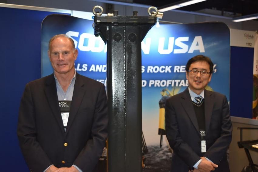 Gregory Henry (L), sales and marketing director, and Sung-Jong Kee, managing director of Soosan Heavy Industries, discuss the company's hydraulic hammers that can satisfy any job requirement at a price that will make your customer smile.