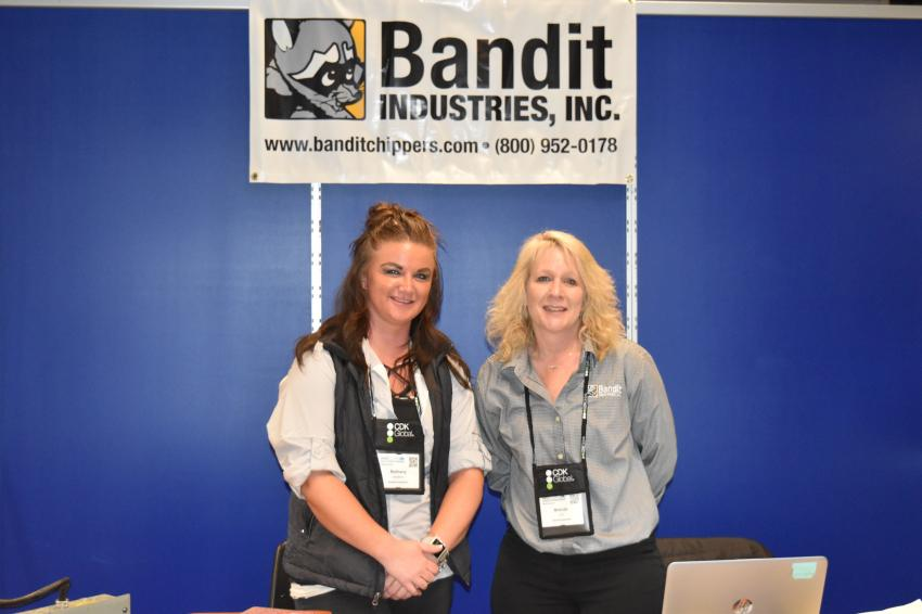 Bethany Lenahan (L), trade show coordinator, and Brenda Lint, sales, of Bandit Industries Inc., an industry leader in wood processing equipment, are ready to talk to AED Summit attendees.